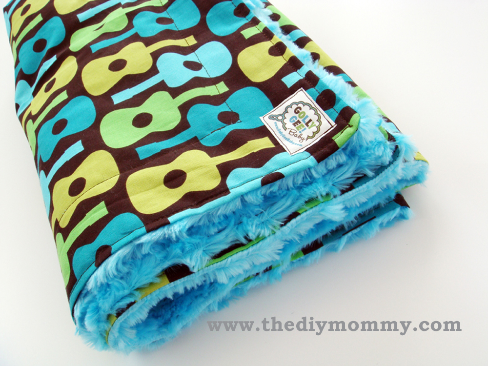 Sew a Boutique Blanket for Baby from The DIY Mommy - Tips on choosing baby-friendly fabric and sewing with minky