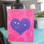DIY Glitter Wall Art for Kids by The DIY Mommy. Use glitter scrapbook paper, fabric and stick-on gems and involve your child in some wall art fun!