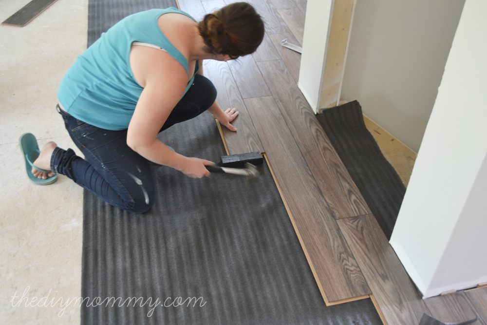 Installing Laminate Flooring by The DIY Mommy. (Allen + Roth Provence Oak Laminate from Lowe's Canada)