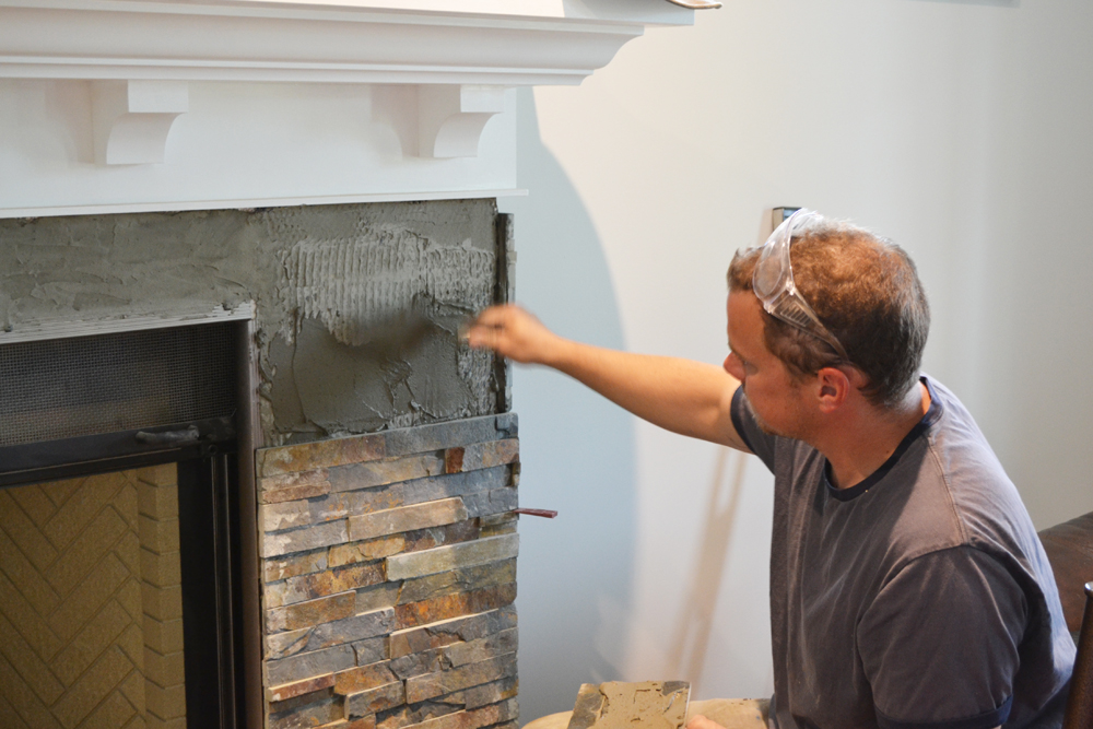 Our Diy Fireplace Installing The Slate Splite Face Tile Mommy