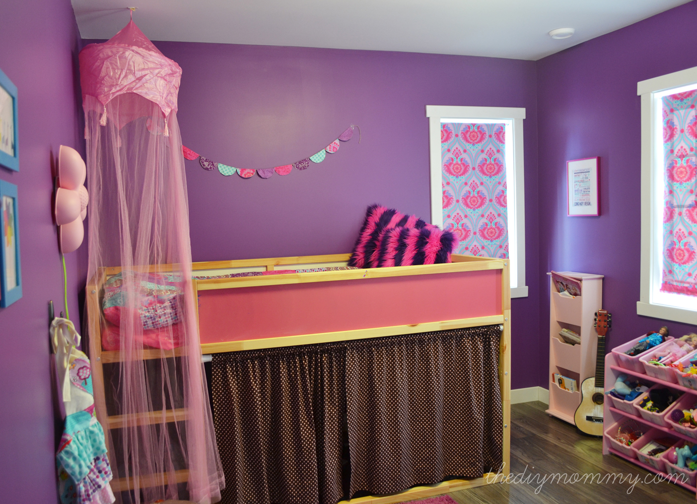 A bright jewel toned kid's room in purple, hot pink and turquoise - The DIY Mommy