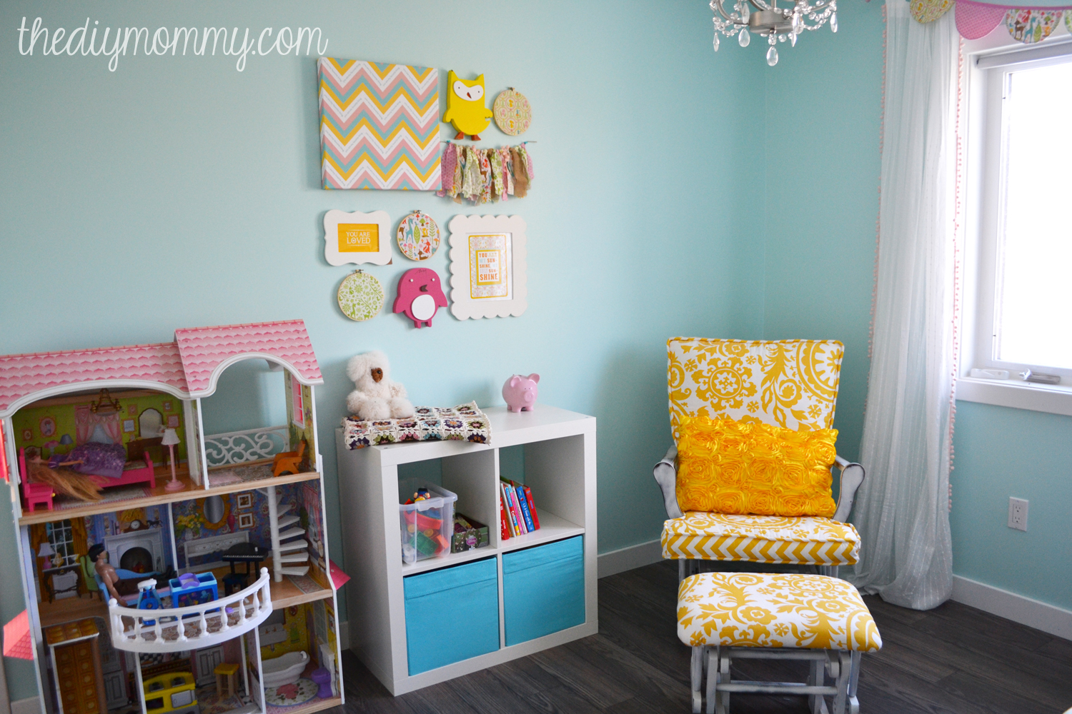 A Sunny Woodland Nursery. This sweet nursery is decorated in aqua, yellow, blush pink and chocolate brown and features a ton of inexpensive DIY decor elements.