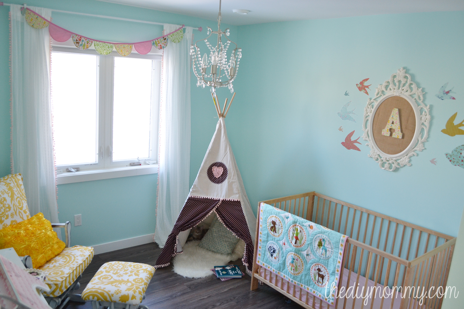 A Sunny Woodland Nursery This Sweet Is Decorated In Aqua Yellow Blush