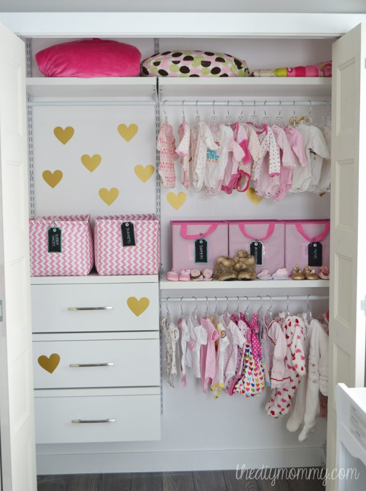 an organized baby closet with closetmaid shelftrack elite 87365