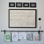 Breakfast Nook Rotating Art Wall by The DIY Mommy. Clip kid's art to a curtain rod installed on the wall!