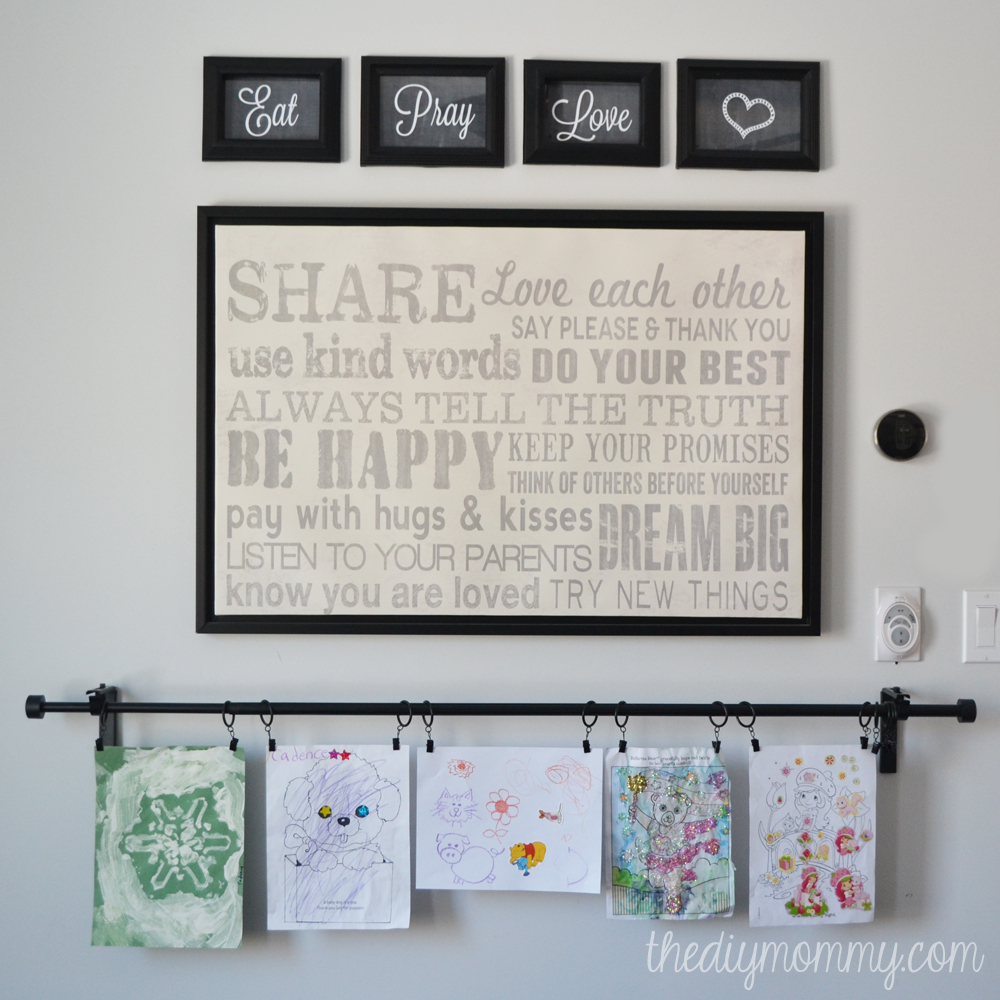 Breakfast Nook Rotating Art Wall by The DIY Mommy. Clip kid's art to a  curtain