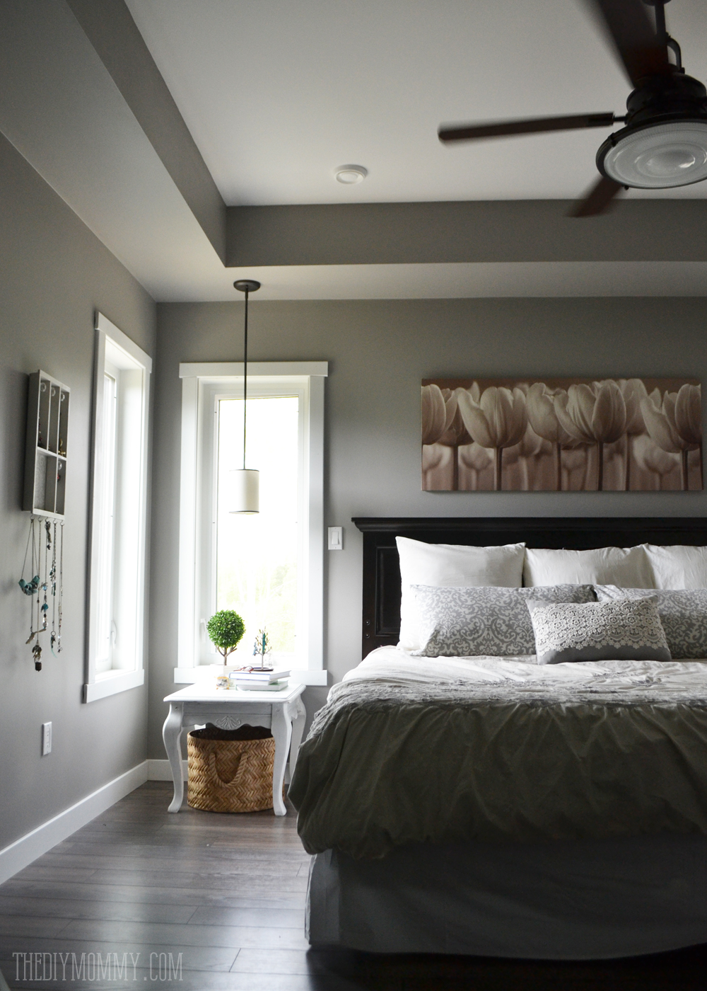 A grey and cream master bedroom design with diy pillow Master bedroom ceiling colors