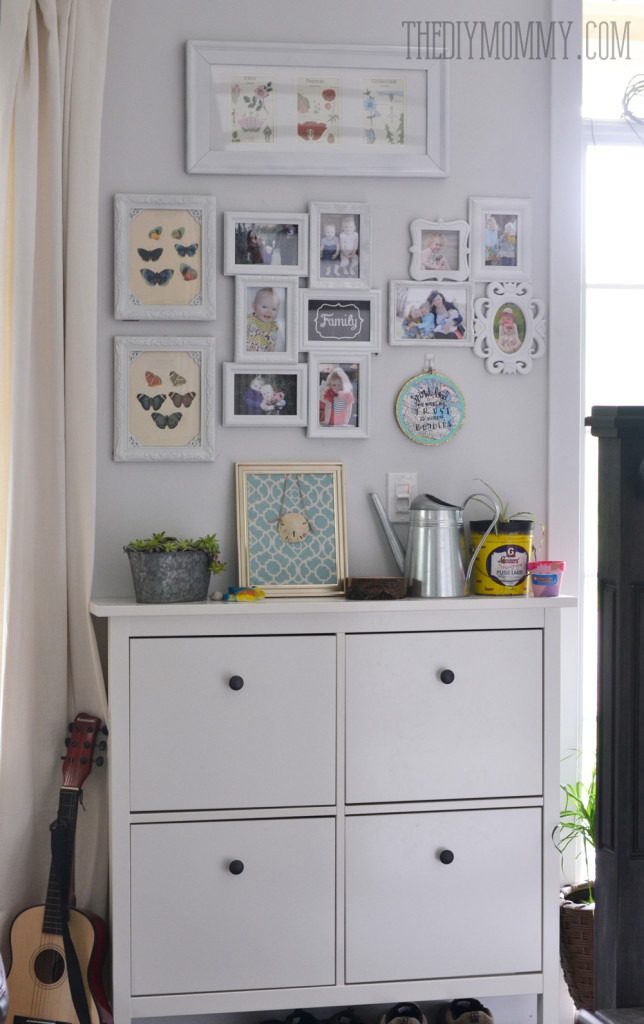 An Ikea shoe cabinet with a gallery wall