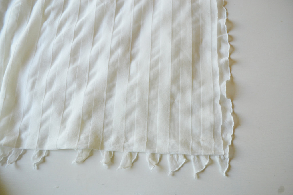 Sew an easy ruffled dust ruffle - just use pre-ruffled fabric!