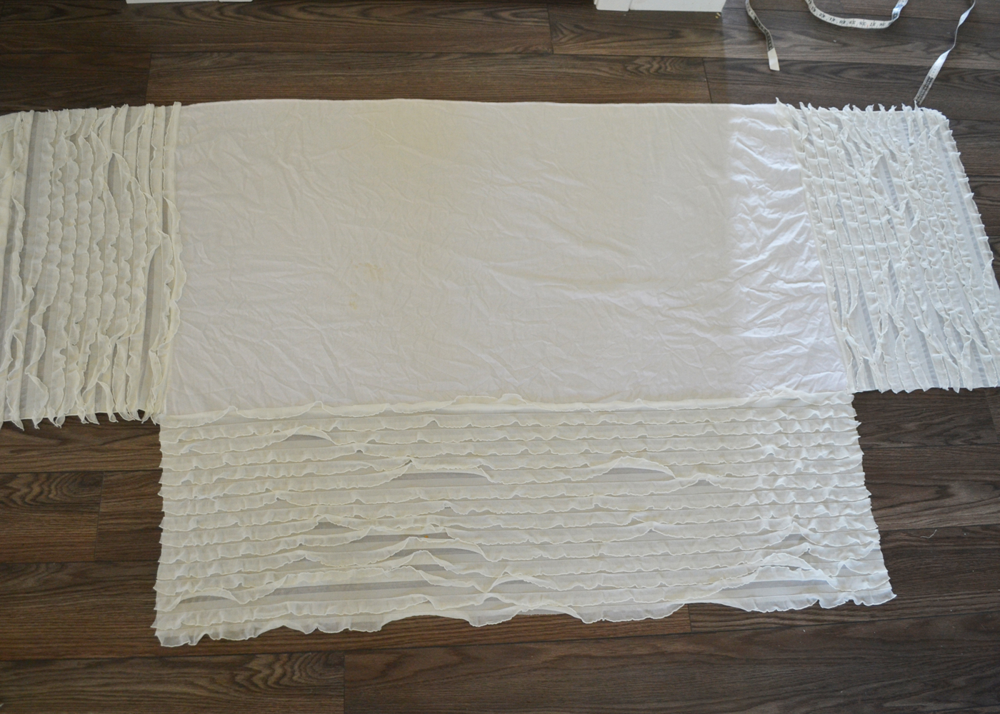 Sew an easy ruffled crib dust ruffle the diy mommy for Sewing material for sale