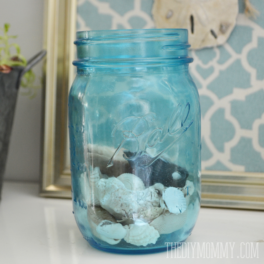 Blue mason jar filled with seashells