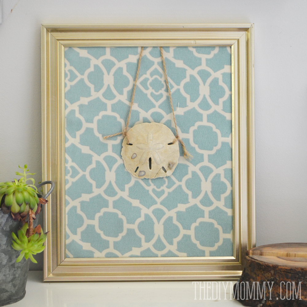 DIY summer sand dollar art made from a picture frame, fabric and string