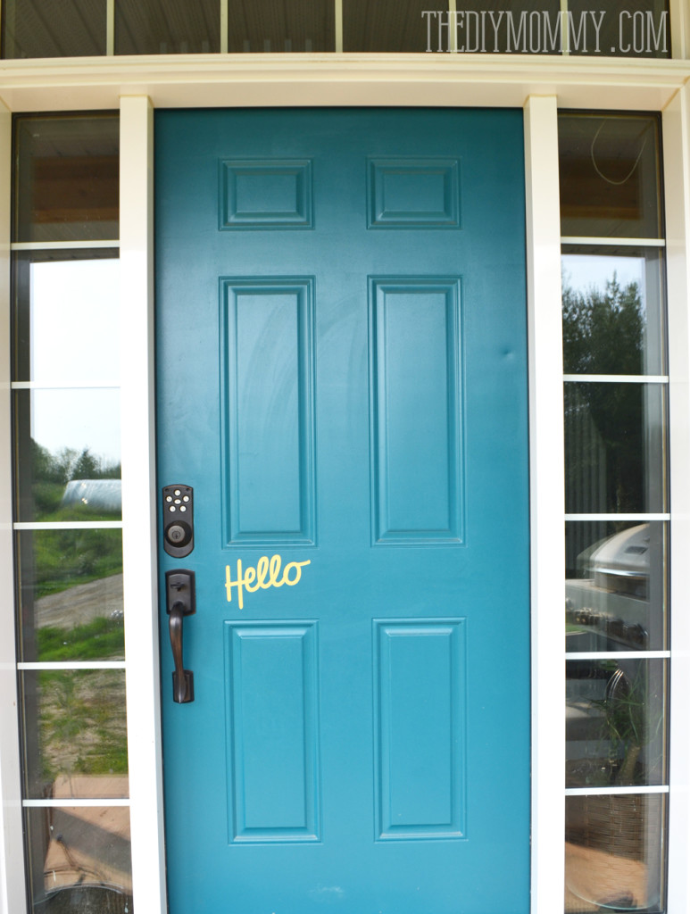 Teal front door with gold hello decal