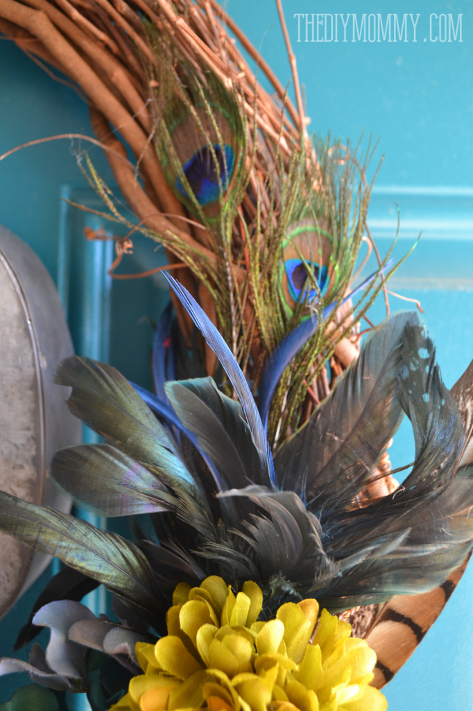 A vintage inspired teal Fall wreath with burlap, feathers, hydrangeas, and a monogram.