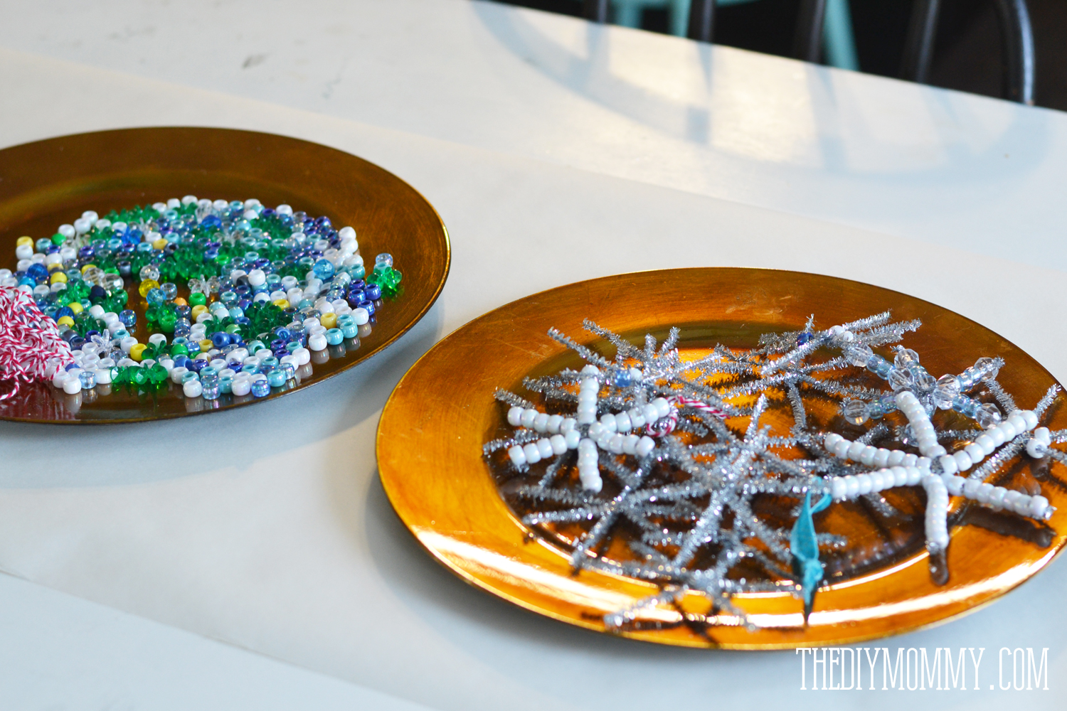 A craft for a Frozen birthday party: snowflake ornaments from pipe cleaners and beads