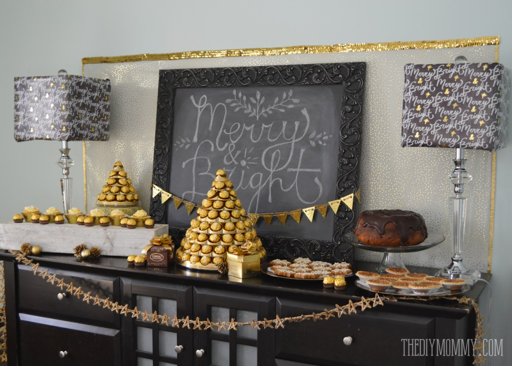 Gold and black glamorous Christmas or New Year's dessert table with Ferrero Rocher