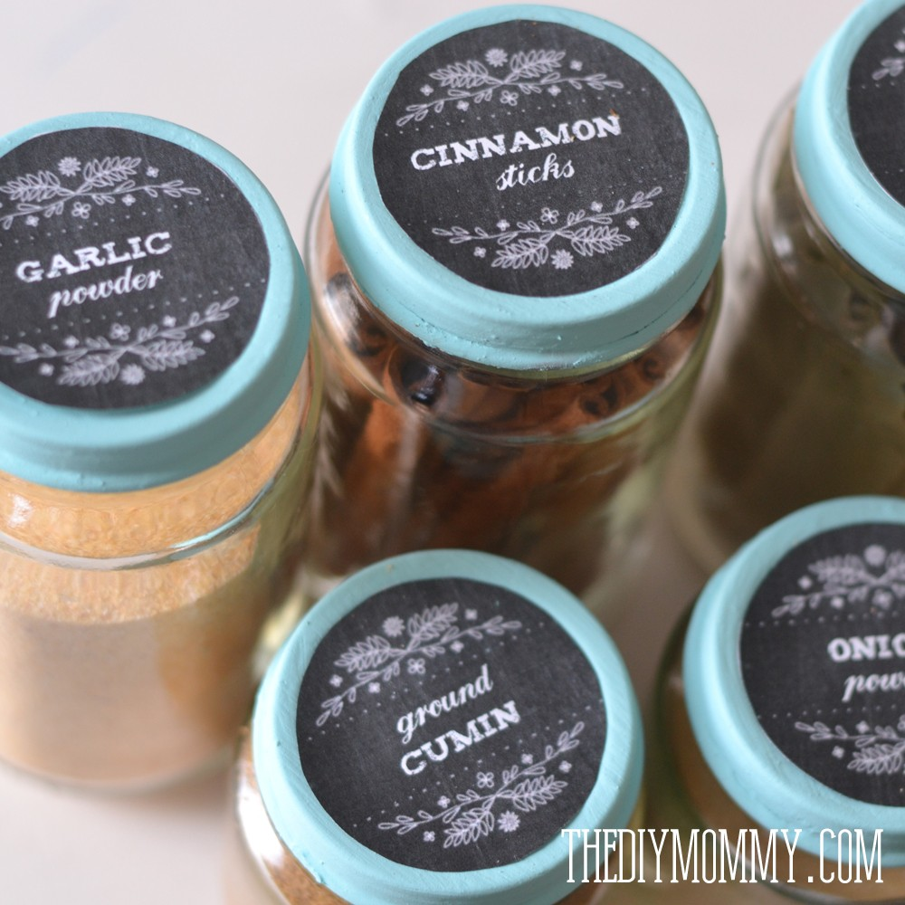 This spice organization idea costs zero dollars and it's so cute - recycle some baby food jars, paint the lids, and stick on some free farmhouse styled labels!