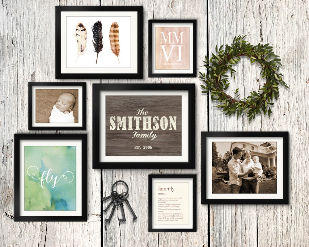 Asymmetrical vintage rustic family gallery wall idea with olive wreath and vintage keys.