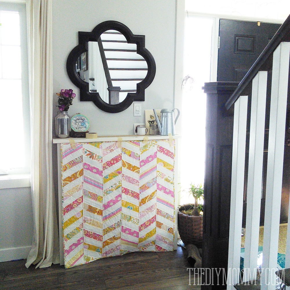Easy DIY first birthday photo booth with special quilt
