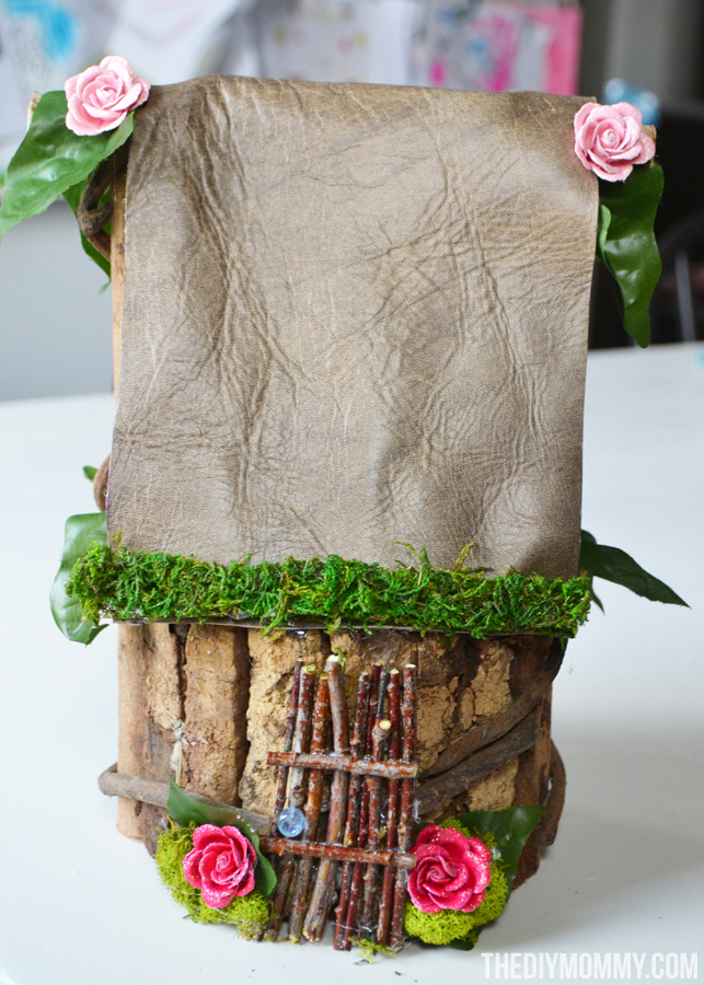 Easy + Inexpensive Fairy Garden: A broken pot, some props made of sticks, and some imagination make a sweet potted fairy garden that doesn't break the bank!