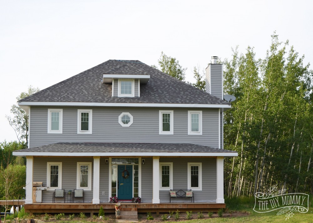Foursquare Home with Gray Siding, White Trim, Teal Door