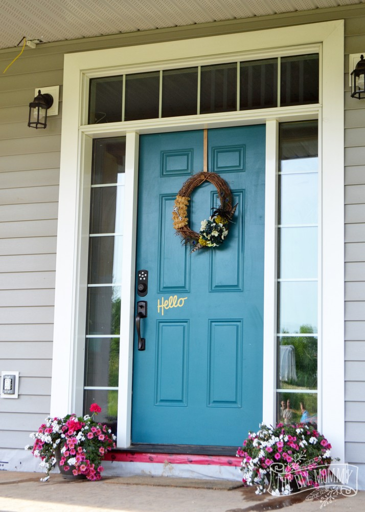Teal front door with sidelites and Hello decal