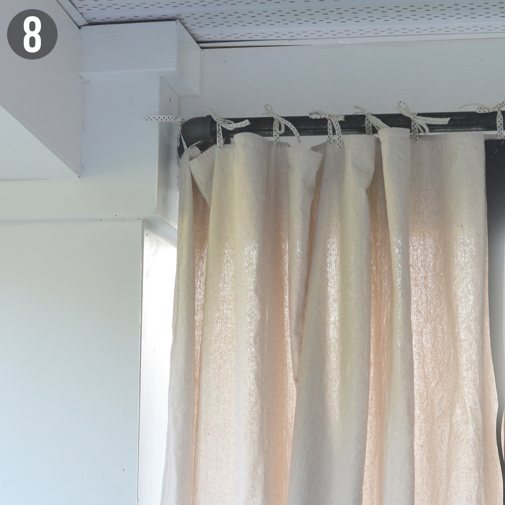 DIY dropcloth outdoor drapes and plumbing parts curtain rod