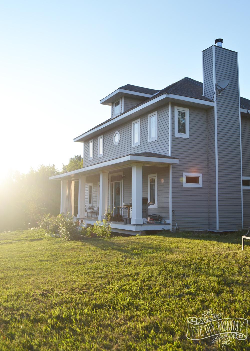 DIY Craftsman Foursquare Home with Grey Siding, Porch with DIY Columns and a Dark Teal Door