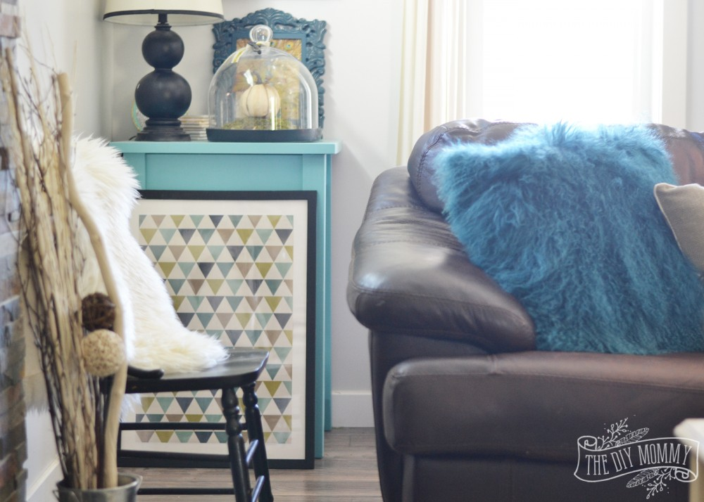 A cozy Fall living room in teal, brown, cream and green