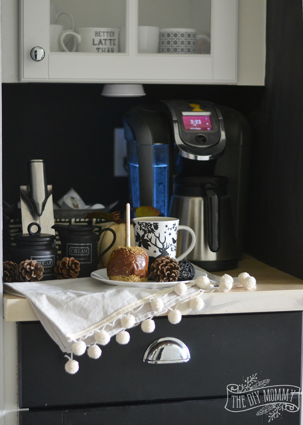 Fall coffee nook with pom pom napkin, caramel apple, chalkboard wall