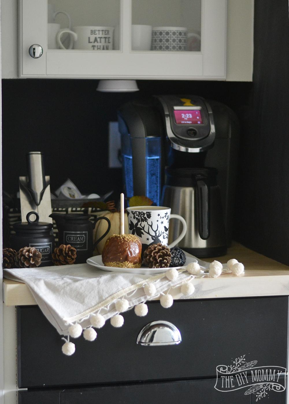 Fall coffee nook with pom pom napkin, caramel apple, chalkboard wall