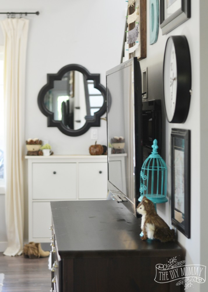 Entry mirror and TV gallery wall