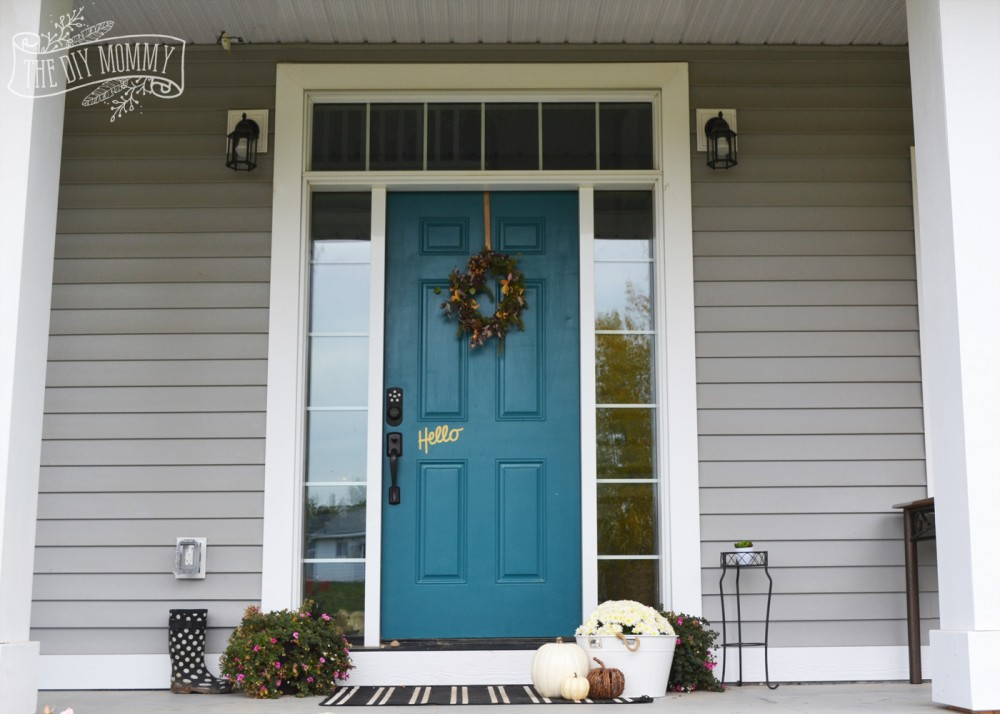 Teal door, white pumpkins, white mums