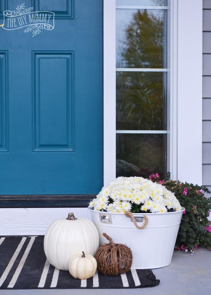 Teal door, white pumpkins, white mums