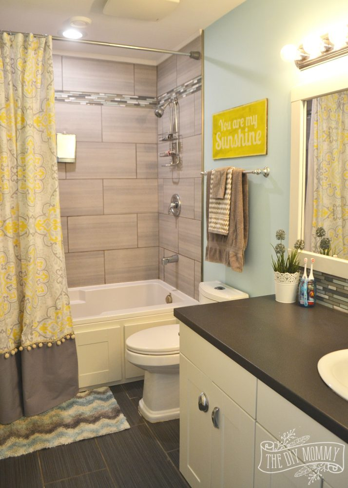 Kids bathroom reveal and some great tips for post reno for Bathroom decor yellow and gray