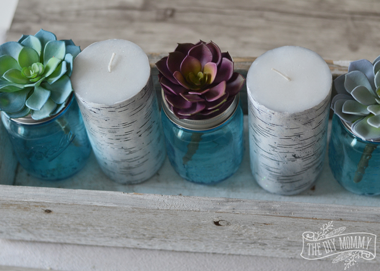 Cute centerpiece idea! Barnwood box filled with mason jars, faux succulents and birch candles.
