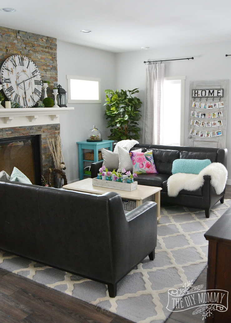 A traditional black and white living room with pops of bright color for Spring