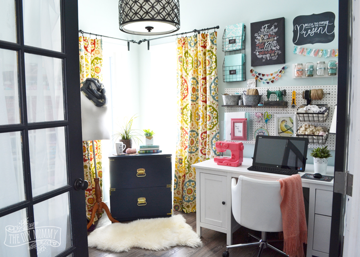 colorful boho craft room home office with tons of great diy decor