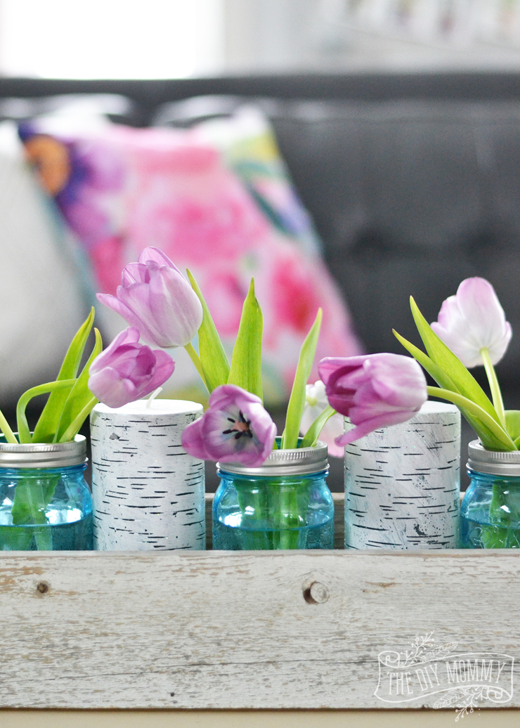 Pink tulips in blue mason jars in a barnwood box centerpiece