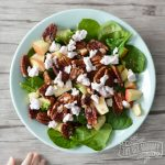 Spinach salad with apples, goat cheese, pecans and raspberry vinaigrette.