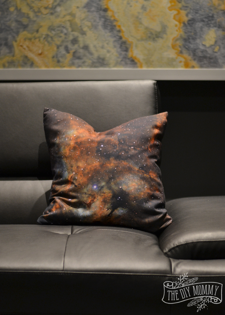 An ultra modern theater room / movie room / man cave design with marble panel artwork in black, grey and rust orange