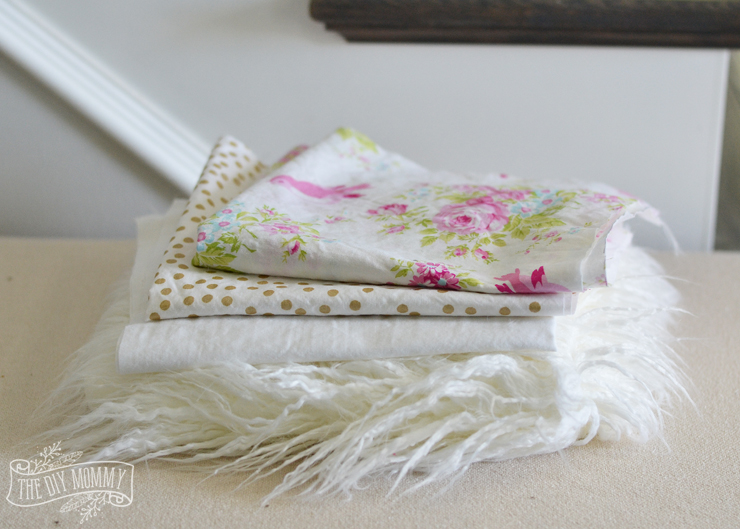 Adorable DIY shabby chic inspired bedding in pink, gold and white for a girls room - instructions and fabric sources.