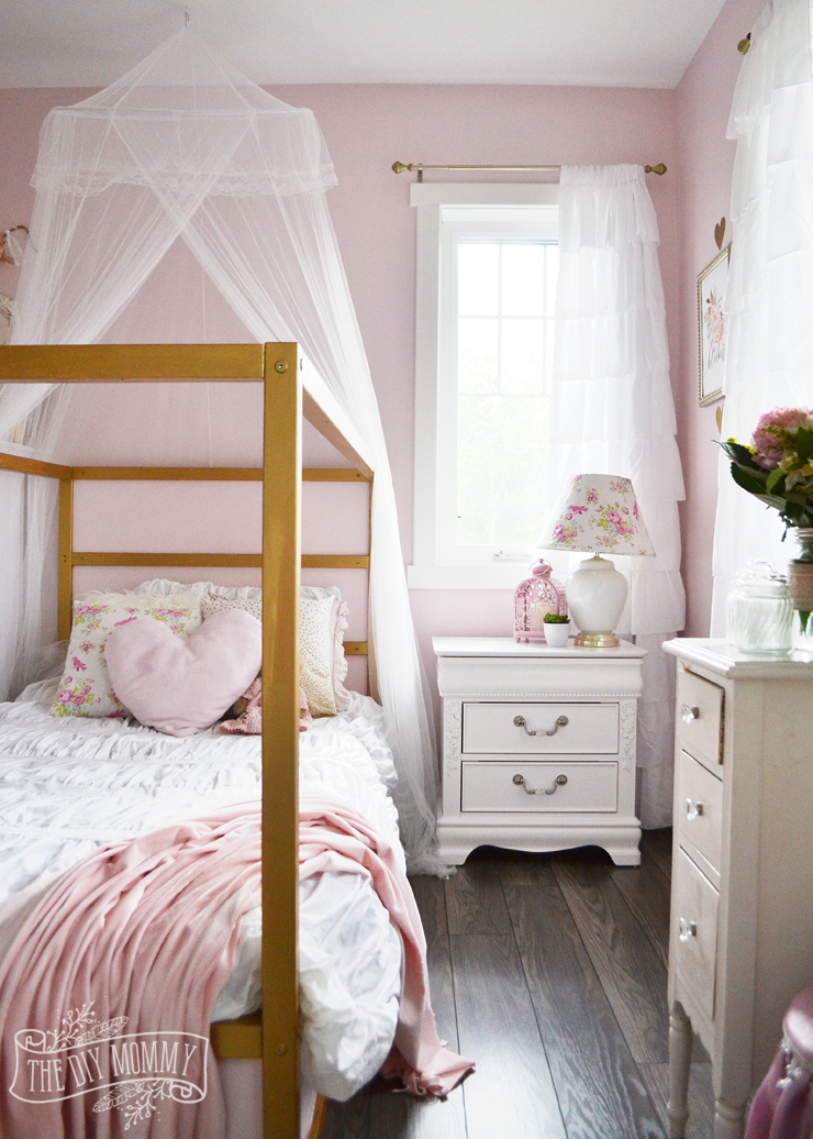 Pink white and gold bedroom