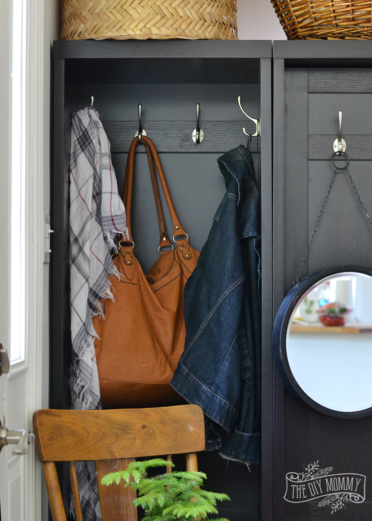 Use a storage or coat cabinet as a room divider to create an entry - black, white and wood farmhouse cottage entryway