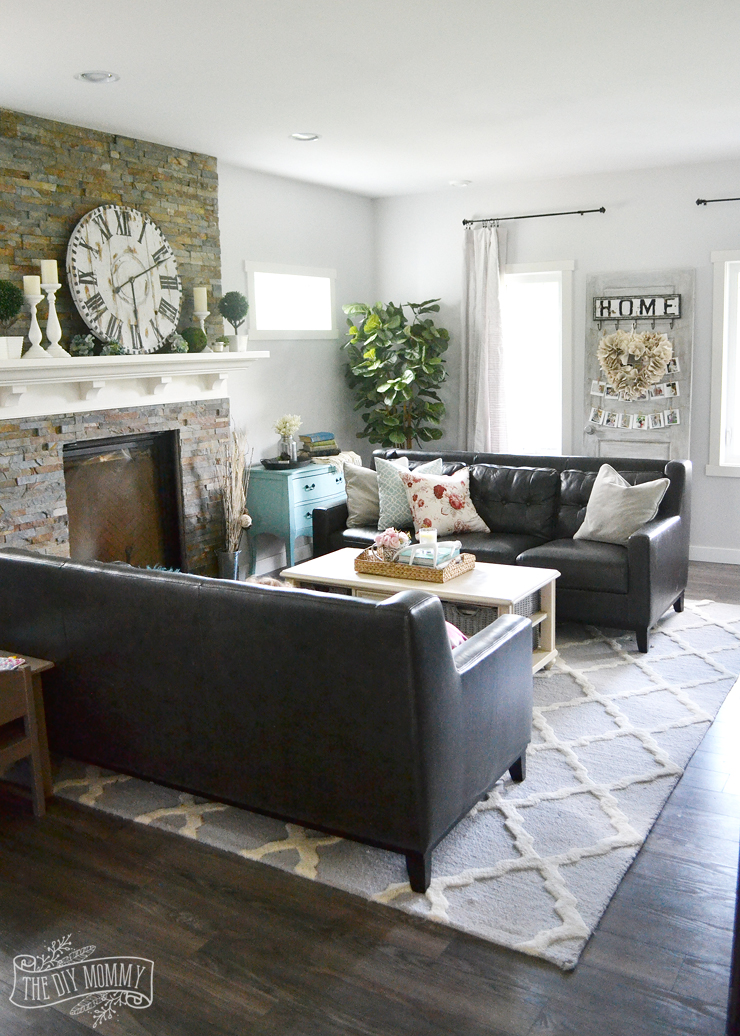 Boho country traditional living room in black, white, and pops of pink and aqua