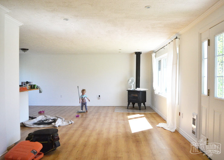 The guest cottage living room painted in Simply White - and Baby B helping me tidy up!
