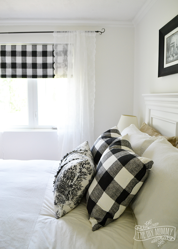 A black and white farmhouse cottage bedroom design with buffalo plaid & toile