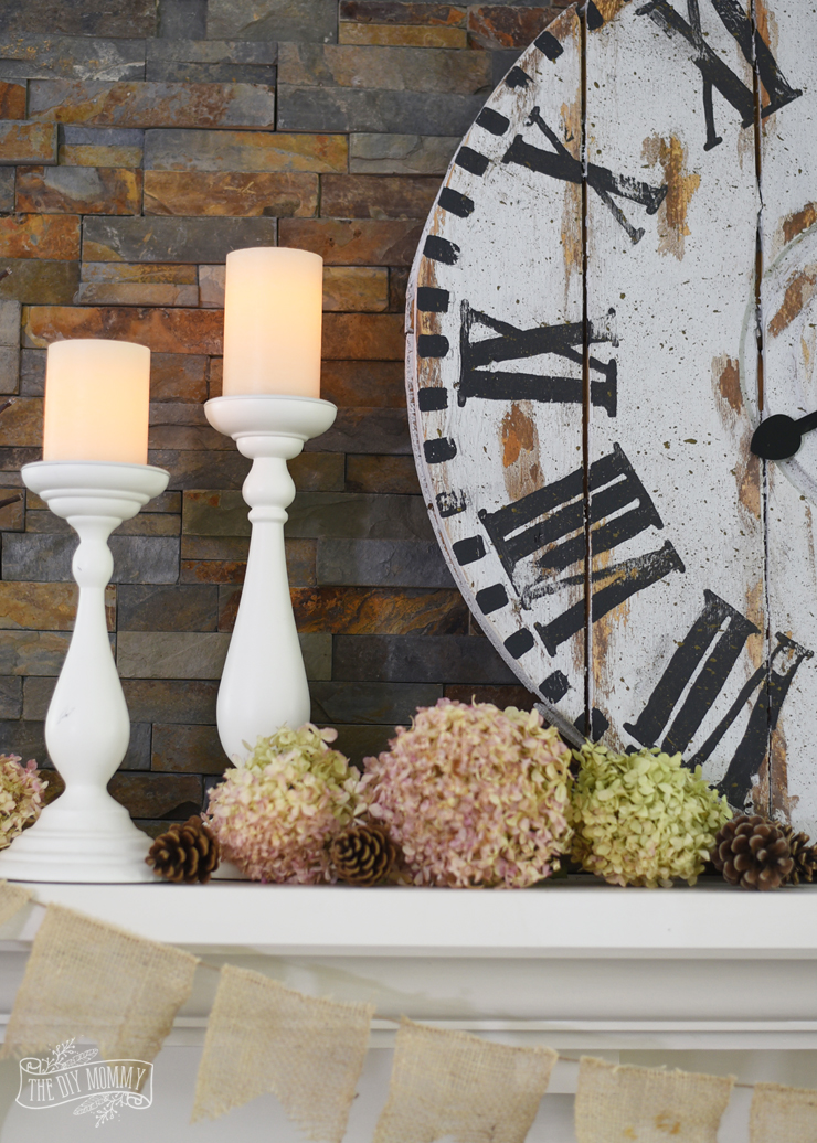 DIY wood clock on a slate fireplace