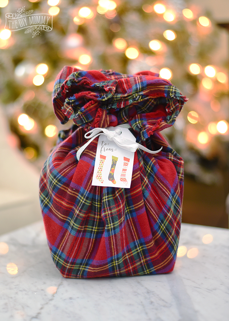 Christmas gift wrapping idea: wrap a gift in a blanket scarf!