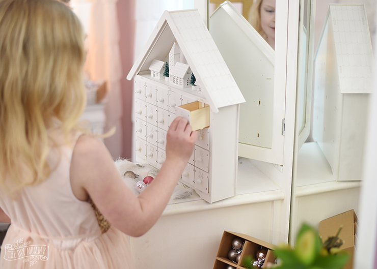White wooden village advent calendar with drawers